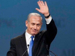 Israeli Prime Minister Netanyahu waves as he arrives to speak at the AIPAC policy conference